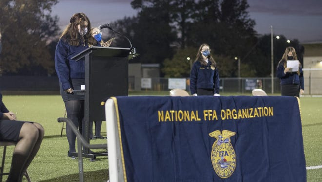 Emma Maag, a senior at TCALC and president of the school's FFA chapter, leads the chapter's chartering ceremony Wednesday evening at Hummer Sports Park.