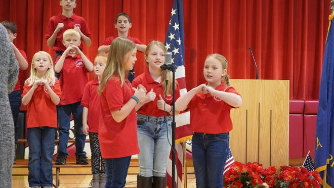 """American Legion Auxiliary Unit 109 and Natoma-Paradise-Waldo USD 399 will co-host the 11th annual Veterans Day Musical Salute. """"This Land is Your Land"""" will again be presented by Natoma USD 399 Students."""