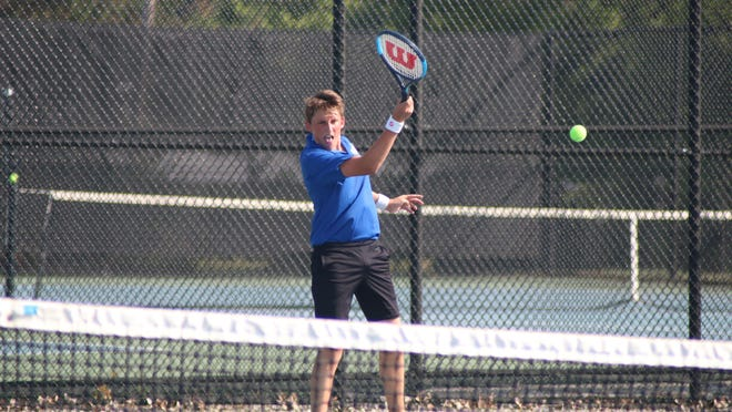 Adrian junior Matt Antalek returns a shot during his match against Pinckney's Mickey Slate during their fourth singles match at Tuesday's SEC White contest. Antalek's 7-5, 6-3 victory was the lone one for the Maples in a 7-1 loss to the Pirates.