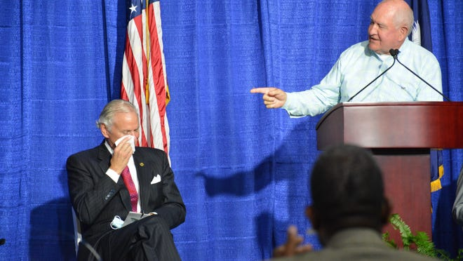 Former Georgia governor and current U.S. Secretary of Agriculture Sonny Perdue, at right, shares a laugh with S.C. Governor Henry McMaster during Wednesday's economic development announcement in Hampton County.