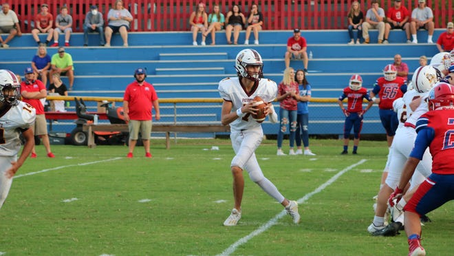 PHA's Zack Mathis drops back to pass.