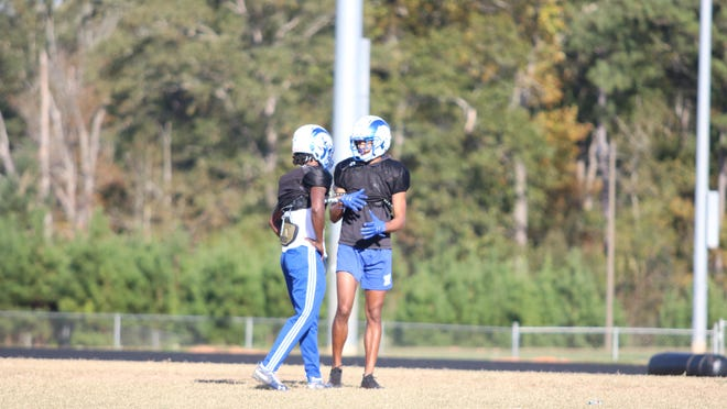 Nyland Green talks with a teammate during practice on Tuesday November 3, 2020.