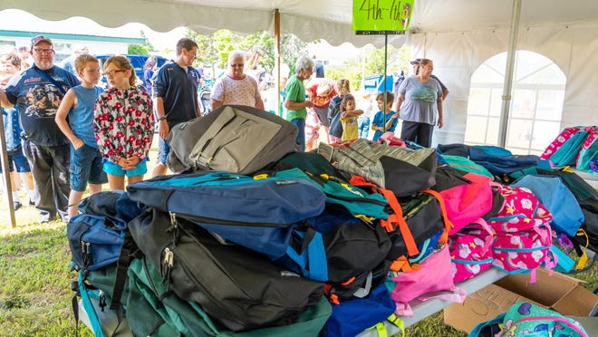 More than 380 backpacks were given out in a past year's Cheboygan Compassionate Ministries' Back to School program. These backpacks were filled with all the school supplies the students needed to get their school year started off on the right foot. Tribune File Photo by Dan Welihan