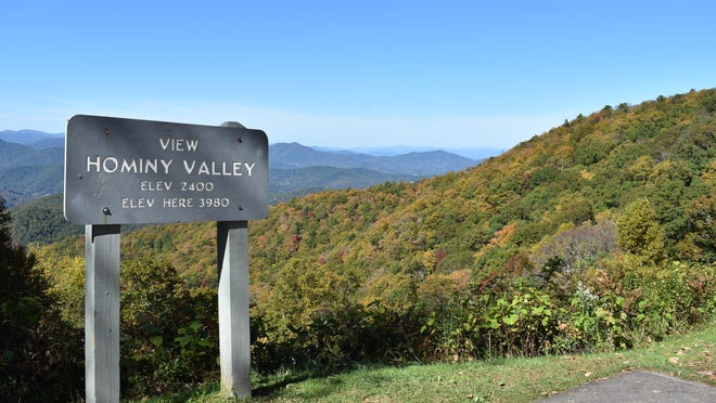 Fall colors were slowly taking over the landscape at the Hominy Valley overlook on the Blue Ridge Parkway Wednesday.