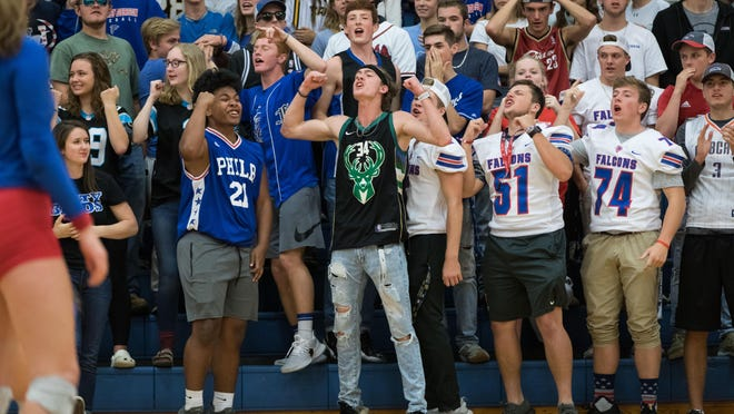 Fans cheer on West Henderson' High School's volleyball team during a conference match at West back in 2018.