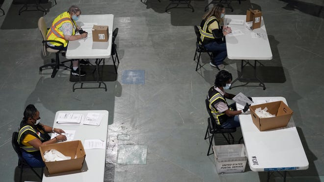 Workers prepare absentee ballots for mailing at the Wake County Board of Elections in Raleigh Sept. 3, 2020.