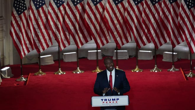 Sen. Tim Scott, R-S.C., speaks during the first night of the Republican National Convention from the Andrew W. Mellon Auditorium in Washington, Monday, Aug. 24, 2020.