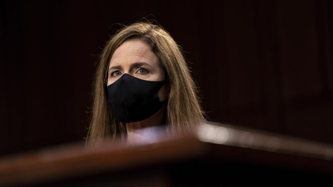 Supreme Court nominee Amy Coney Barrett listens during her Senate Judiciary Committee confirmation hearing on Capitol Hill in Washington, Monday, Oct. 12, 2020.
