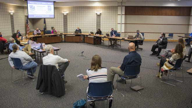 Staff at Washburn Rural High School and Washburn Rural Middle School talk with the Auburn-Washburn Board of Education at the board's Monday evening meeting about the challenges and successes they have seen under hybrid learning.