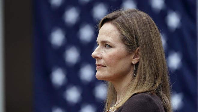 Judge Amy Coney Barrett listens as President Donald Trump announces her as his nominee to the Supreme Court in the Rose Garden at the White House on Saturday.