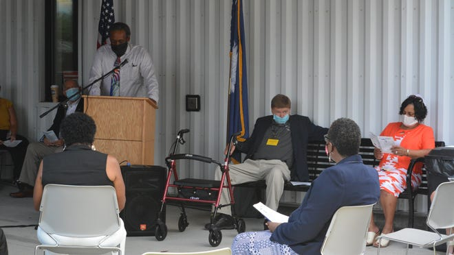 Hampton County Historical Society member Al Wiggins addresses the crowd during Friday's Opening Ceremonies, while at right HCHS President Steve Kemmerlin looks on.
