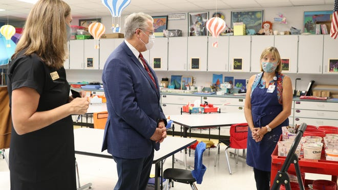 U.S. Rep. Rick Allen (center) and Dr. Karen Heid (right) talk during Allen's tour of Lake Forest Hills Elementary School on Tuesday.