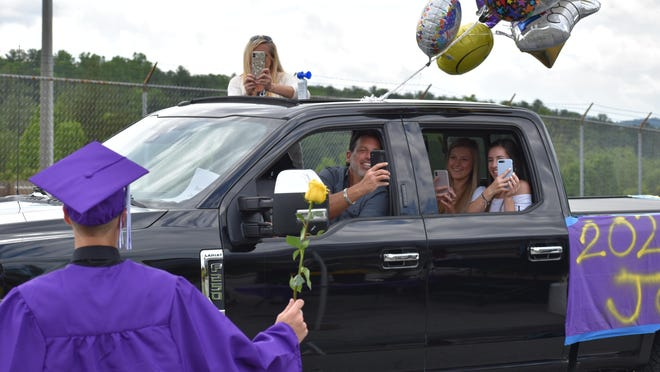 North Henderson High held a drive-through graduation ceremony Friday, with families showing support from decorated vehicles. Graduating seniors were unable to have a traditional ceremony due to the COVID-19 pandemic.