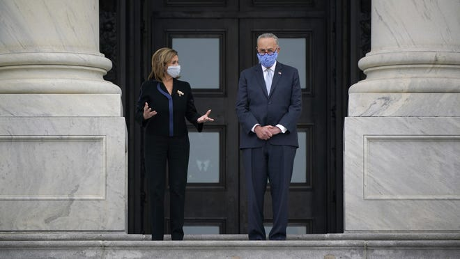 Speaker of the House Nancy Pelosi, D-Calif., left, talks with Senate Minority Leader Chuck Schumer, D-N.Y., as they wait for the start of a ceremony at the Capitol in Washington, Friday, Sept. 25, 2020, to honor the late Justice Ruth Bader Ginsburg who died last week at age 87 of cancer.