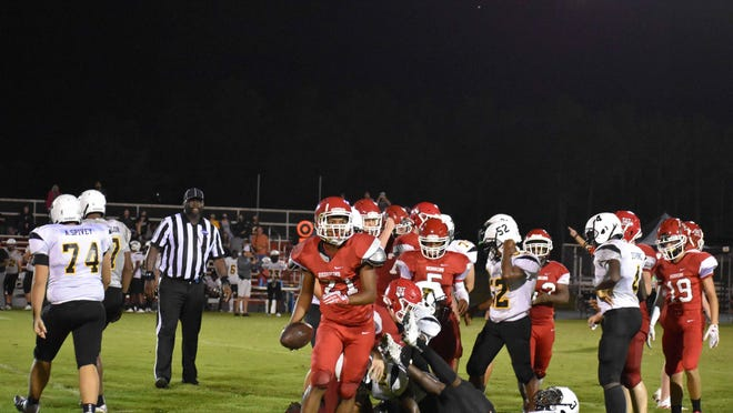 Bryan County's Jamari Flannel (21) holds the ball after recovering an East Laurens fumble on Friday night in Pembroke.