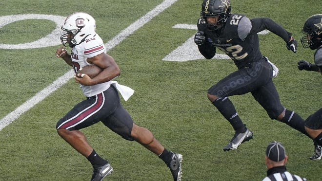 South Carolina running back Kevin Harris (20), a Bradwell Institute graduate, leaves Vanderbilt defensive back Chase Lloyd (22) behind as Harris runs 25 yards for a touchdown in the second half Saturday in Nashville, Tenn. Harris ran for two TDs and a career-high 171 yards in the 41-7 victory.