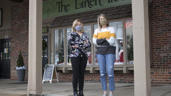 Debbie Alvey, a worker at The Linen Tree, and store owner Kelly Schuster said they are ready to kick off the busy holiday season safely with Small Business Saturday.