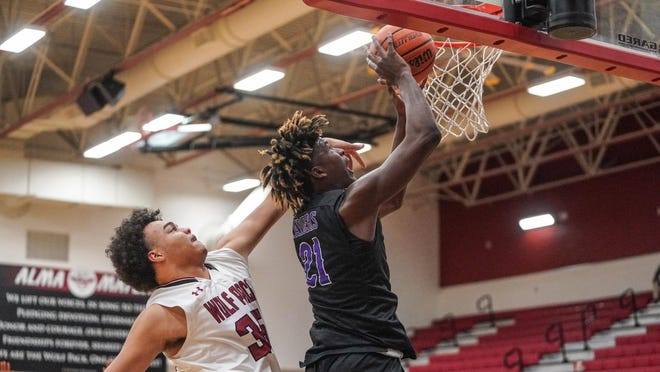 Weiss' Cameron Jackson, left, defends Cedar Ridge's Marcel Bryant Dec. 1 in a nondistrict game at Weiss High School. Weiss beat the Raiders 59-43.