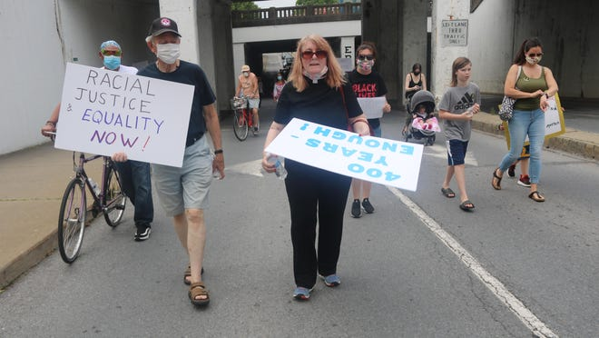 Ann Akers, seen here at the Black Lives Matter march in June, talked about having a SURJ (Showing up for Racial Justice) chapter in Port Jervis.