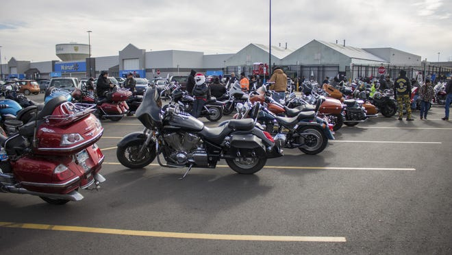 Dozens of motorcyclists spread out in the 37th Street Walmart parking lot ahead of a ride up Topeka Boulevard to deliver gifts for the U.S. Marine Corps Reserve's Toys for Tots program.