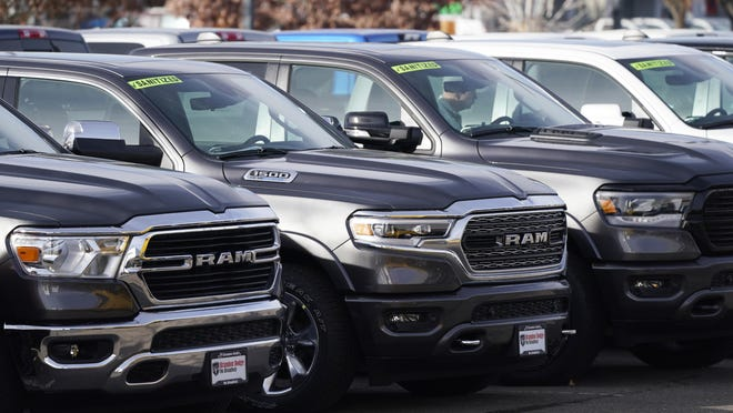 A long row of unsold 2020 pickup trucks sits at a Ram dealership Sunday, Dec. 27, 2020, in Littleton, Colo. A new government report says gas mileage for new vehicles dropped and pollution increased in model year 2019 for the first time in five years.