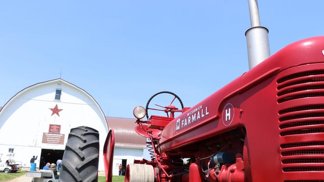 A McCormick Farmall tractor is displayed May 18, 2019, in the field in front of the Farmer's Antique Tractor and Engine Association spring show barn. The association has announced the cancellation of its fall tractor show, scheduled for September.