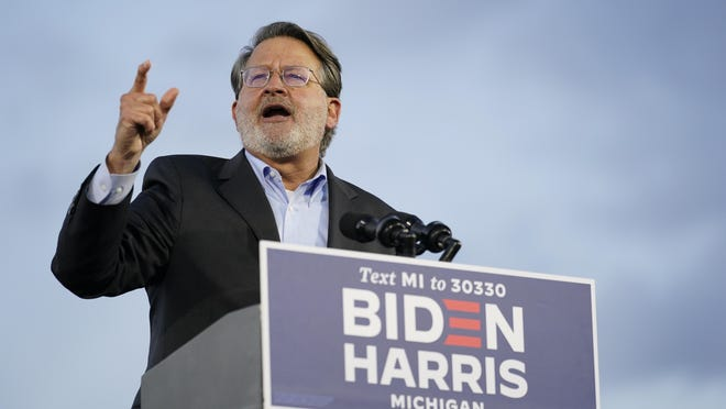 Sen. Gary Peters, D-Mich., speaks during an event for Democratic presidential candidate former Vice President Joe Biden at the Michigan State Fairgrounds in Novi, Friday, Oct. 16.