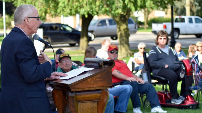 Former state Senator and Representative Bruce Caswell addressed the 9/11 commemoration Friday evening at Four corners in Coldwater.