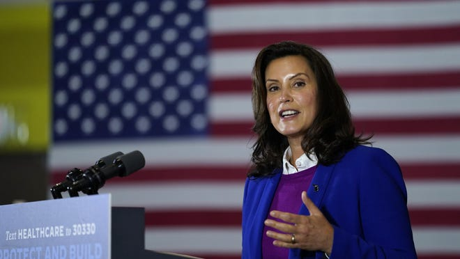 FILE - In this Friday, Oct. 16, 2020 file photo, Michigan Gov. Gretchen Whitmer speaks during an event with Democratic presidential candidate former Vice President Joe Biden at Beech Woods Recreation Center in Southfield, Michigan Gov. Gretchen Whitmer on Thursday, Nov. 19, 2020 repeated her plea to Michigan residents to limit gatherings at Thanksgiving and keep loved ones safe. Whitmer's appeal came as the state health department reported 7,592 new confirmed cases of the coronavirus and 134 deaths, including 61 that were added after a records review..