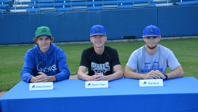Dalton Graham, Spencer Piippo and Matt Bush, pictured from left to right, have commited to the Bay College Norse baseball program. The EUP trio got together Tuesday at James Field to announce their college decisions.