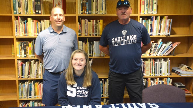 Julia Beaumont of Sault Ste. Marie has signed to attend and play basketball at Bay College. Julia is pictured with, (from left) Sault High girls basketball coach Pat Bennin, and her father Ernie Beaumont.