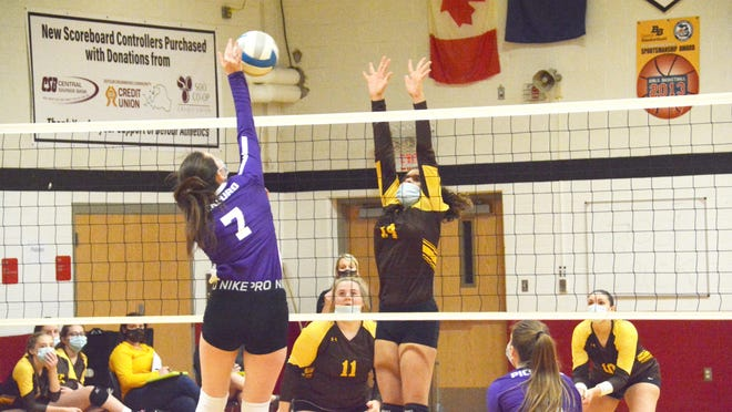 Jocelyn Portice of Pickford (7) tries to hit past Pellston's Hail Williams (14) during a district championship volleyball match at DeTour Thursday night.