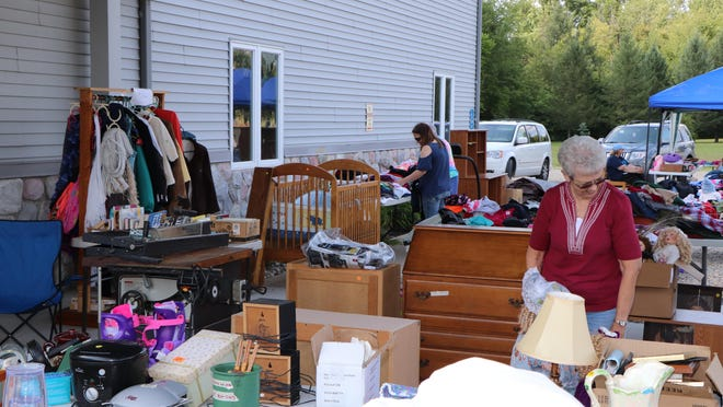 """The U.S. 127 Yard Sale, dubbed as the """"world's longest yard sale,"""" travels the interstate route from Alabama through Addison each summer. Despite the coronavirus pandemic, the yard sale event is being planned for Aug. 6-9. Pictured here from the 2018 sale are goods and buyers at the New Life Baptist Church in Woodstock Township."""