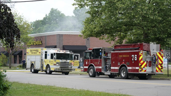 Smoke billowing from the Dollar General on North Evans Street in Tecumseh after a fire that started inside the building in the early afternoon Monday.