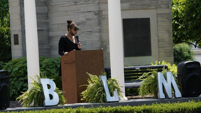 """Bryianna Wilson, a rising senior at Adrian College, speaks during Saturday's rally on the college campus. Students and alumni at Adrian College organized a peaceful rally in support of Black Lives Matter and creating a cultural change on Adrian's campus. """"It's not that no other lives don't matter, it's that Black Lives Matter,"""" Wilson said. """"It is our reality and it makes me sad how many Americans are hurting right now."""""""