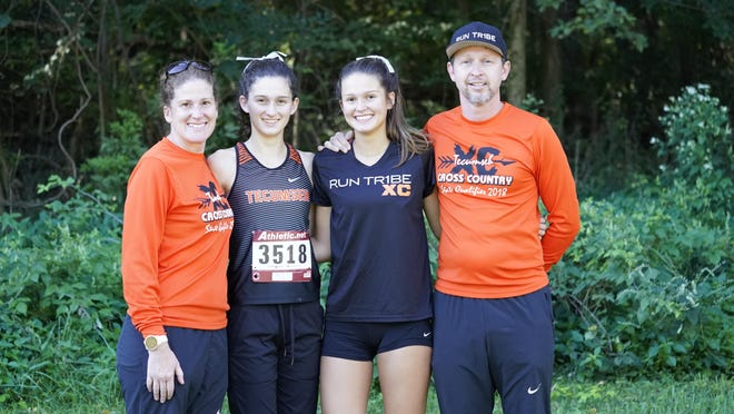 Tecumseh girls cross country coach Wendy Knape, left, poses for a picture with her daughters Kaitlin, middle left, Kelsey, middle right, and husband Ryan.