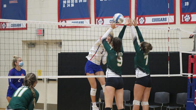 Lenawee Christian's Isabelle Kirkendall (3) fires a kill attempt against a block by Sand Creek's Lauren Johnston (9) and Madison Serin (7) during the first set of their match at Saturday's LCS Quad meet. LCS defeated Sand Creek and the Kalamazoo Home School team to finish 2-1 at the meet, while the Aggies went 1-2 Saturday with a win over the Kalamazoo Home School team.