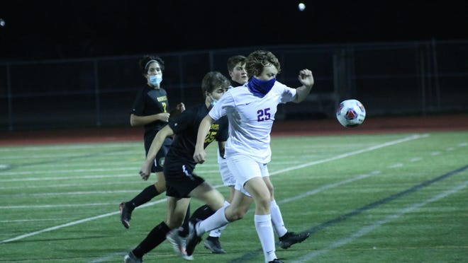 Lenawee Christian senior Ethan Van Dam, right, battles, Clarkston Everest Collegiate's Joey Thibodeau during the Division 4 state semifinal game on Wednesday night at Troy Athens High School. The Cougars picked up the victory 2-0 to advance to their first-ever state finals appearance.