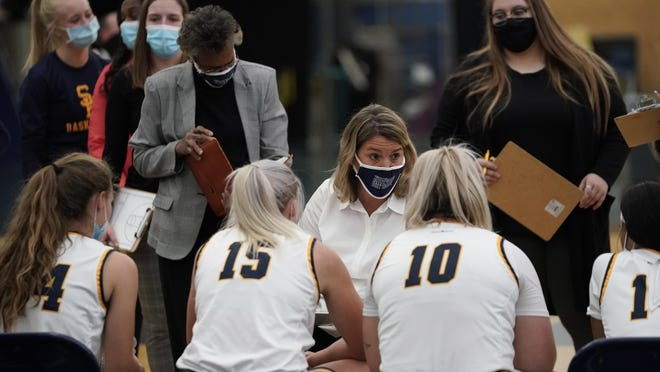 Siena Heights women's basketball coach and interim athletic director Sue Syljebeck talks with her team during SHU's game against Grace Christian on Nov. 2. Syljebeck, the program's all-time wins leader, hit the 300-win mark with the Saints in Saturday's 119-86 victory over Bethel (Ind.)