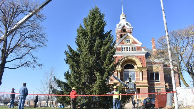 The City of Adrian-Lenawee County Christmas tree was installed Thursday morning at the old Lenawee County Courthouse. The installation process was completed in record time this year, just over four hours total, according to former Adrian Mayor Jim Berryman, who coordinates the project.