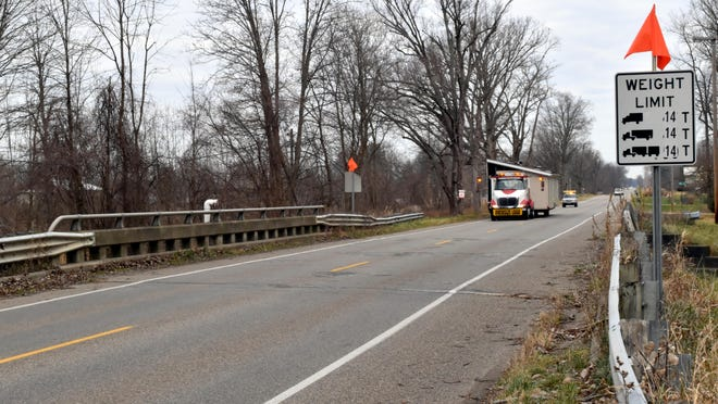 Dips in the road bed are visible on Marshall Road at the Girard bridge. Inspectors required the maximum weight limit reduced from 50 to 14 tons, following an inspection last week.