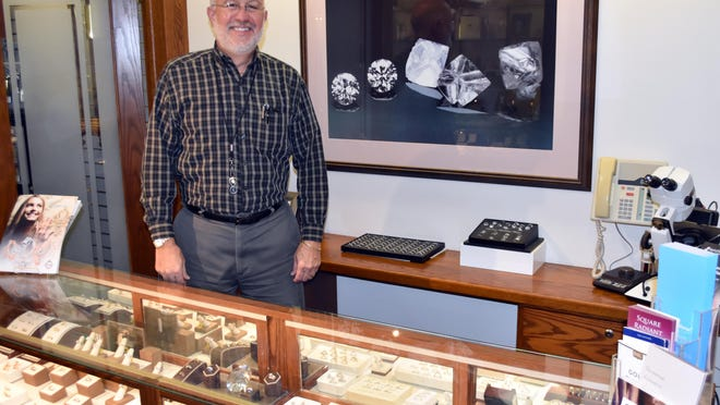 Brad Rockey, of Keiss Jewelry, among the engagement and wedding rings which are popular sellers this holiday season.