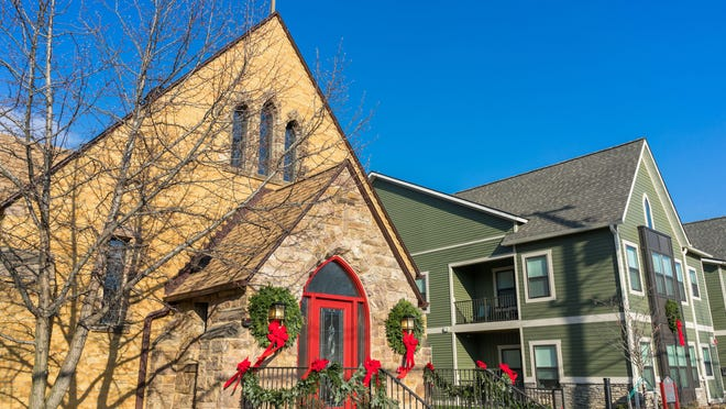 In an innovative approach to providing housing, this neighborhood church building in West Michigan was converted into six apartments, with townhomes constructed on the parking lot.