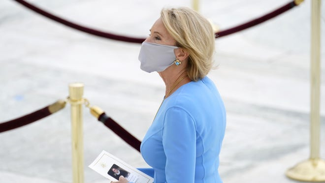 Education Secretary Betsy DeVos pays her respects as Justice Ruth Bader Ginsburg lies in repose on Sept. 24 in Washington. DeVos has tested negative for coronavirus, her office said Friday, following the news that President Donald Trump and his wife had tested positive.