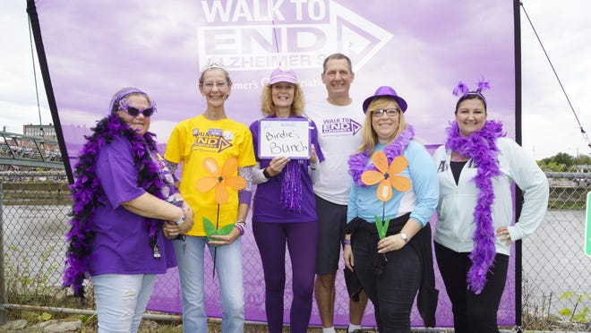 Local group Birdie's Bunch poses for a photo during last year's Walk to End Alzheimer's. Group leader Nancy Cosby is shown second from left. The group is returning for Saturday's event.