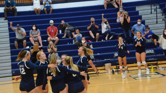 Sault High players celebrate a point during a home match this season. The Blue Devils defeated Boyne City 3-1 in a non-conference match Monday night.