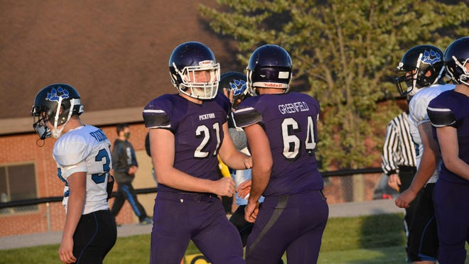 Pickford's Micah Bailey (21) and Nate Greenfield (64) celebrate a touchdown during the season opener against Superior Central last week. The Panthers visit Cedarville this Friday night.