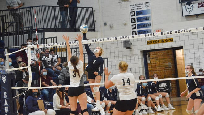 Jordyn Haller (1) of Sault High attacks during a match against Cheboygan. The Blue Devils downed Cheboygan and Onaway in a tri-meet Thursday night.
