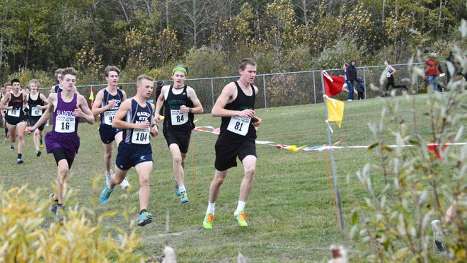 Sault High's Jaron Wyma (number 104) and Gladstone's Drew Hughes (16) are among the leaders in early race action at the Sault Elks Invitational Saturday. Hughes and Wyma finished 1-2 in the boys varsity race.