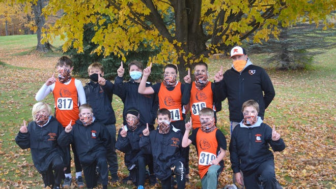 Rudyard won both the Eastern UP and Straits Area Conference boys middle school team cross country championships this season. The Rudyard team includes, front row, from left: Steven Kirschner, Jarrett Smith, Eli Folkersma, Ty LaLone, Dwight Green and Jeremiah Clark; back row, from left: Kyle Postma, Ethan Clark, Matt Perkins, Jace Anderson, Cameron Willis and coach Billy Mitchell.